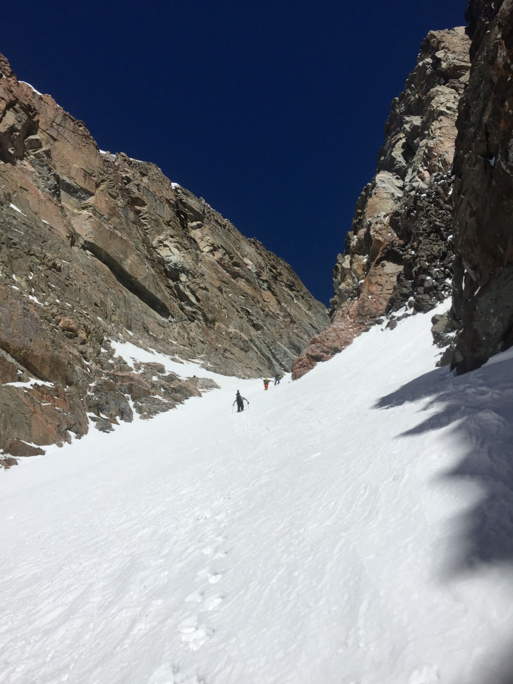 The team chasing the shade up the Couloir.