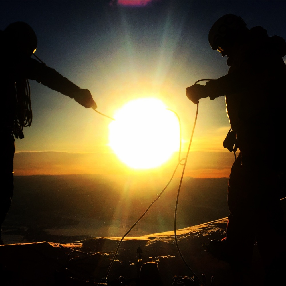 Fredrick Marmsater and Tanner Flanagan prepare the ropes while enjoying the sunrise on the Teepee Glacier.